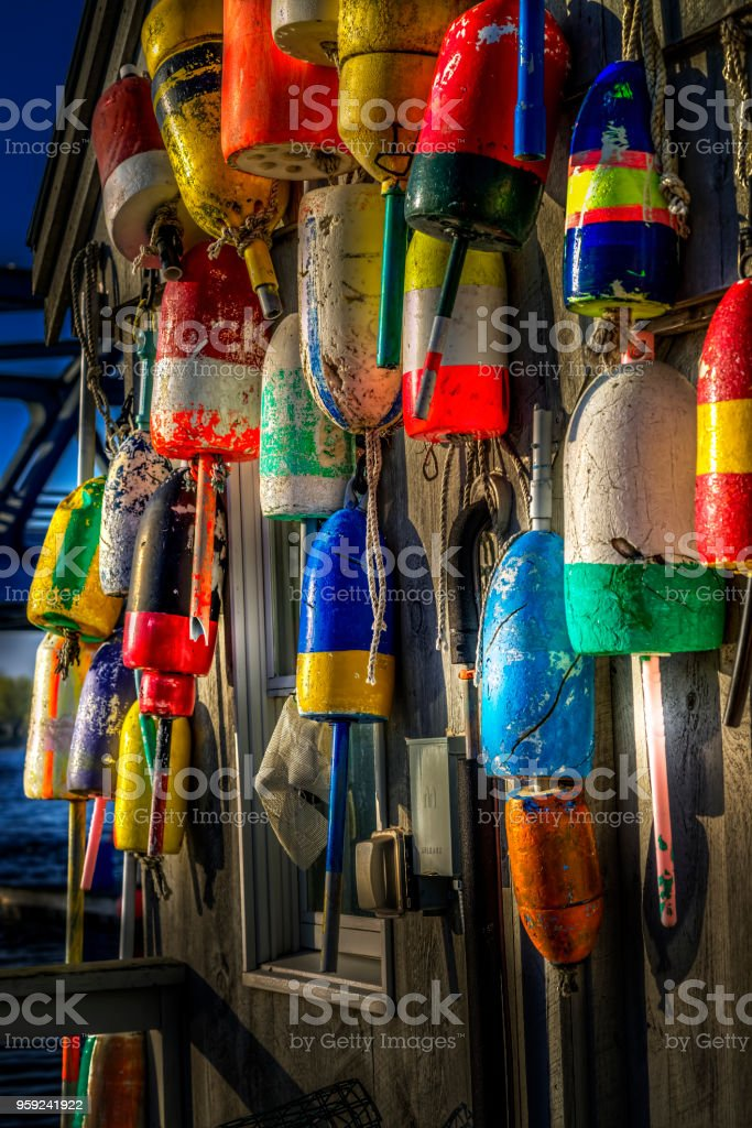 Colorful Lobster Buoys on lobster shack stock photo