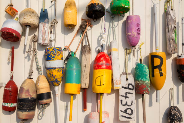 colorful lobster buoys on the wall of the house buoys hanged on wooden wall gloucester massachusetts stock pictures, royalty-free photos & images