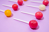 Colorful Lollipops on pink background