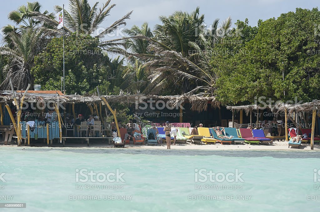 colorful lounge chairs at sorobon beach , bonaire royalty-free stock photo