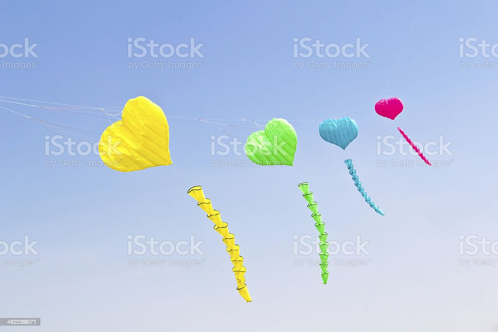 colorful love heart kite against blue sky royalty-free stock photo