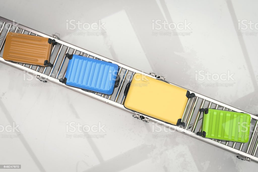 colorful luggages on conveyor belt stock photo
