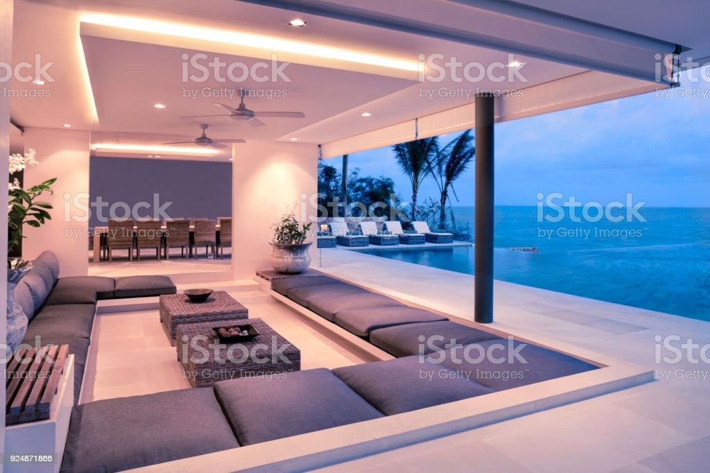 Indoor Outdoor Tropical Chalet With Infinity Pool At Twilight