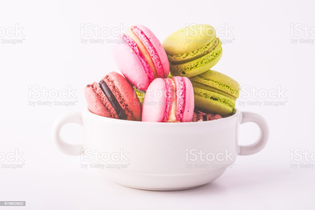Colorful macaron cookies. Isolated on white background royalty-free stock photo