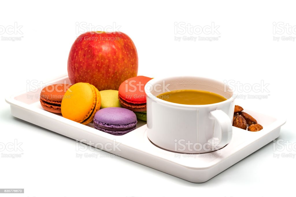 Colorful Macarons, Apple, Almonds and a cup of Coffee stock photo