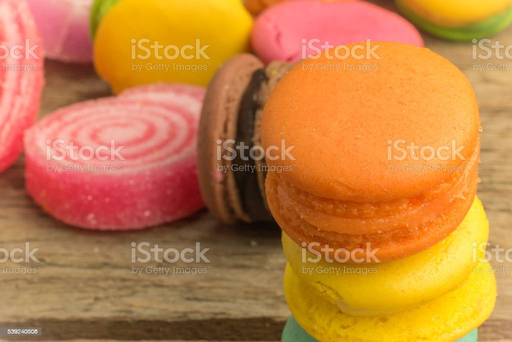 colorful macarons on a woody floor royalty-free stock photo