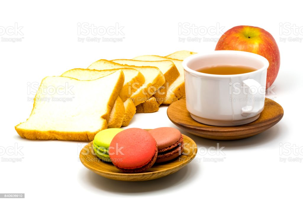 Colorful macarons on wooden plate stock photo