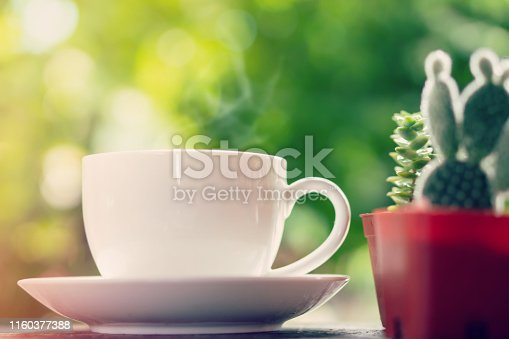 istock colorful macarons with hot coffee cup over nature garden in background 1160377388