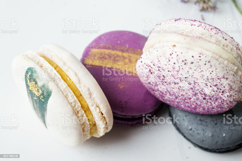 colorful macaroon cakes  against white background stock photo