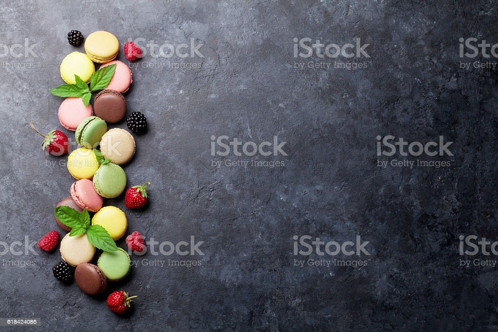 Colorful macaroons and berries stock photo