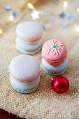 Colorful macaroons and cinnamon sticks .Christmas card