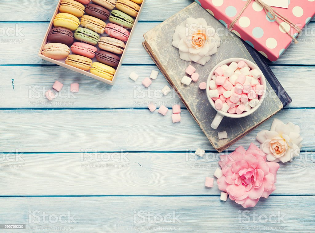 Colorful macaroons in a box and marshmallow