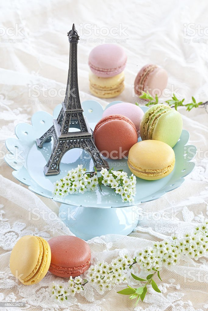 Colorful macaroons on blue plate stock photo