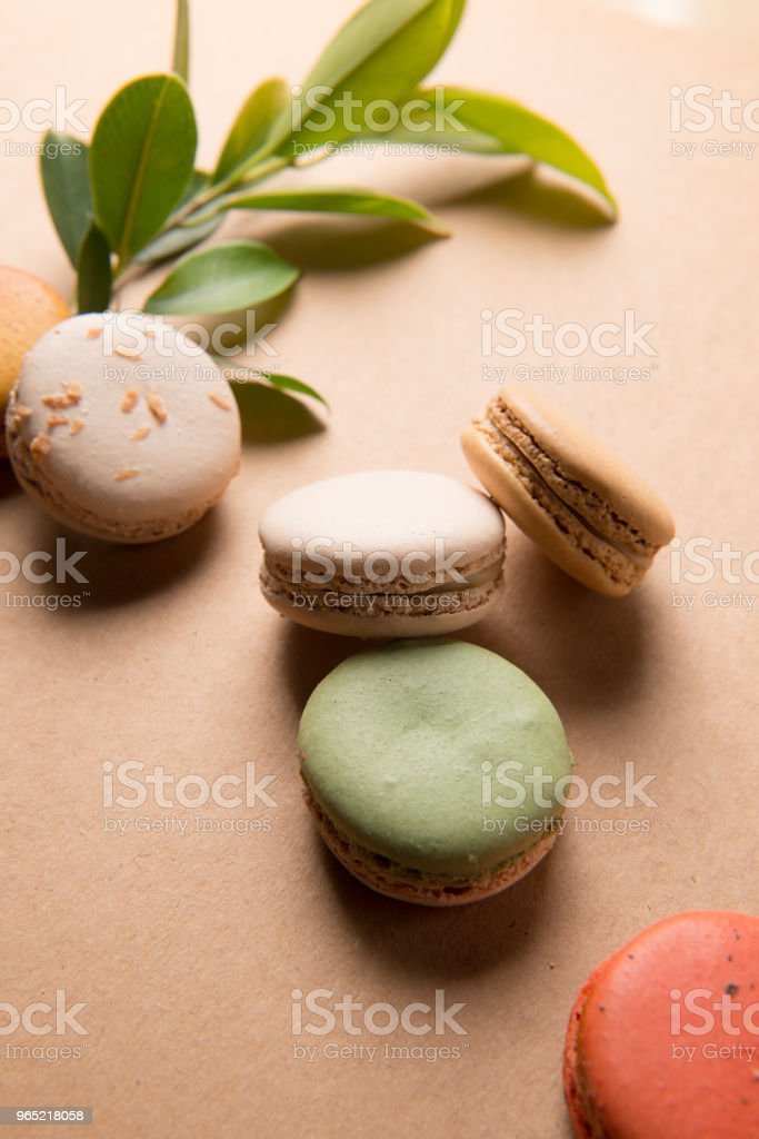 Colorful macaroons. Sweet macarons on retro  background . zbiór zdjęć royalty-free