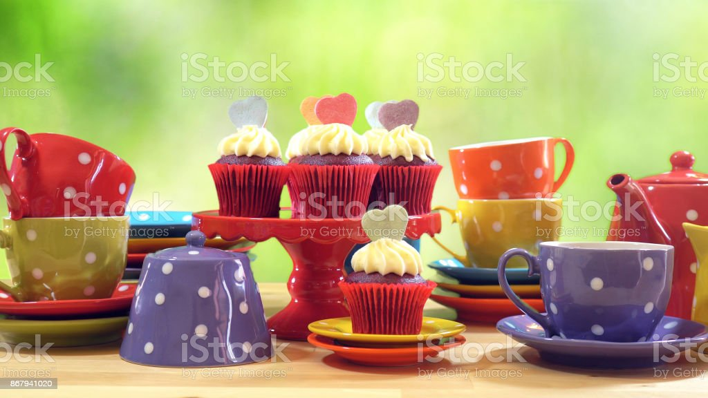 Colorful Mad Hatter style tea party with cupcakes stock photo