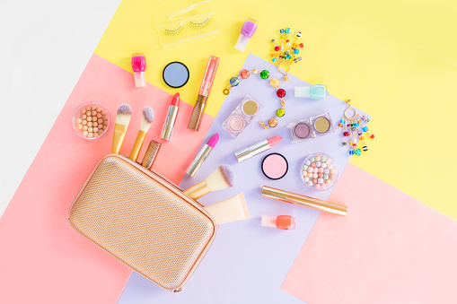 Colorful make up flat lay scene