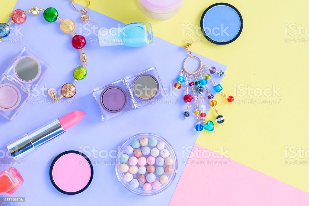 Colorful make up flat lay scene stock photo