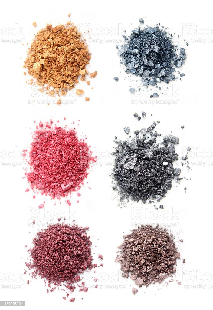 Colorful makeup crushed into piles royalty-free stock photo