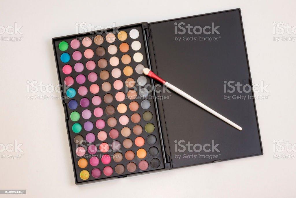 Photo of colorful eye shadows makeup set in box. Eye shadows...