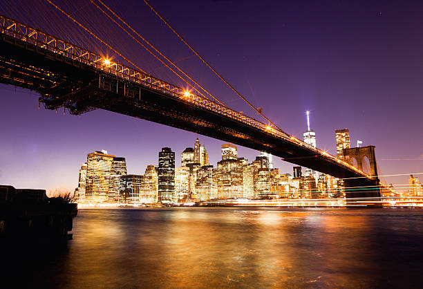 Colorful Manhattan Skyline with Brooklyn Bridge Manhattan skyline south street seaport stock pictures, royalty-free photos & images