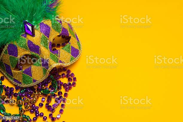Colorful Mardi Gras Or Venetian Mask On A Yellow Stock Photo - Download Image Now
