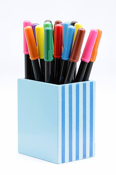 Colorful markers in blue wooden bin stock photo