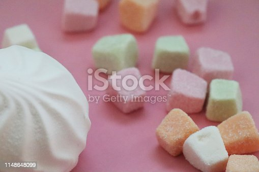 istock Colorful marshmallows on pink background 1148648099