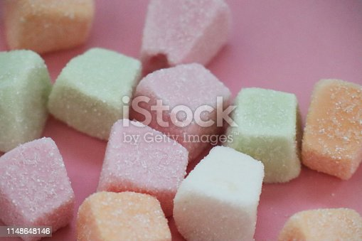 istock Colorful marshmallows on pink background 1148648146
