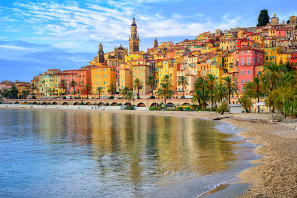 Colorful medieval town Menton on Riviera, Mediterranean sea, France Sand beach beneath the colorful old town Menton on french Riviera, France provence alpes cote d'azur stock pictures, royalty-free photos & images