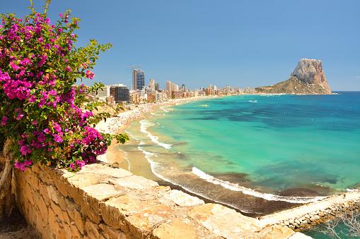 Colorful Mediterranean seascape. Mountain Penyal d'Ifach. Calpe beach, Spain.