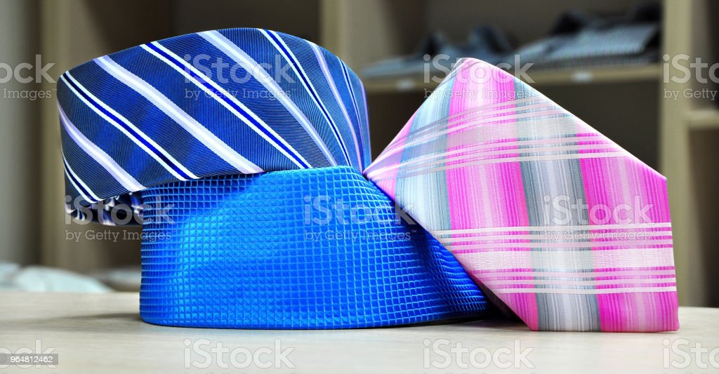 Colorful men's tie collection.Display of different patterns and colours of man ties in a shop or showroom royalty-free stock photo