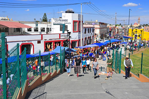 Colorful Metropolitan area of Puebla City, Mexico Puebla, Mexico - December 30, 2012: Characterized by its vibrantly colored buildings and narrow streets, Puebla is a popular spot for tourists, despite being built under multiple active volcanoes.  orizaba stock pictures, royalty-free photos & images