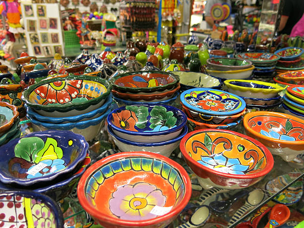 Colorful Mexican Kitchen Bowl Pottery with Flower Patterns stock photo