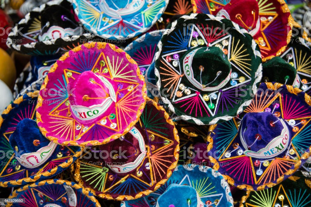 Colorful Mexican sombrero hats at an outdoor market stock photo