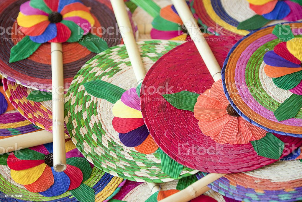 Colorful Mexican Straw Fans in Market royalty-free stock photo