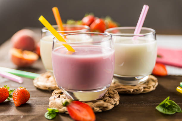 Colorful milkshakes on a wooden table stock photo