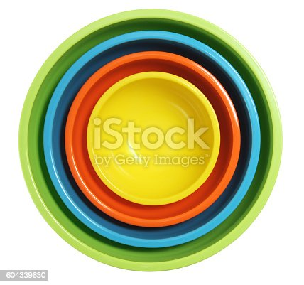 Colorful mixing bowls on white