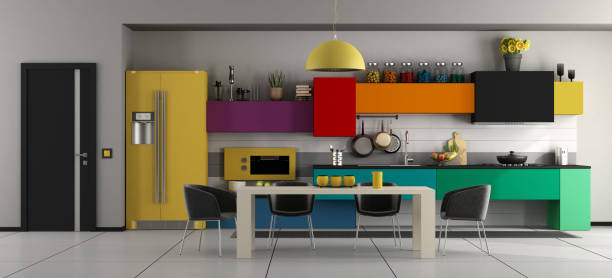 Colorful modern kitchen with table and chairs stock photo