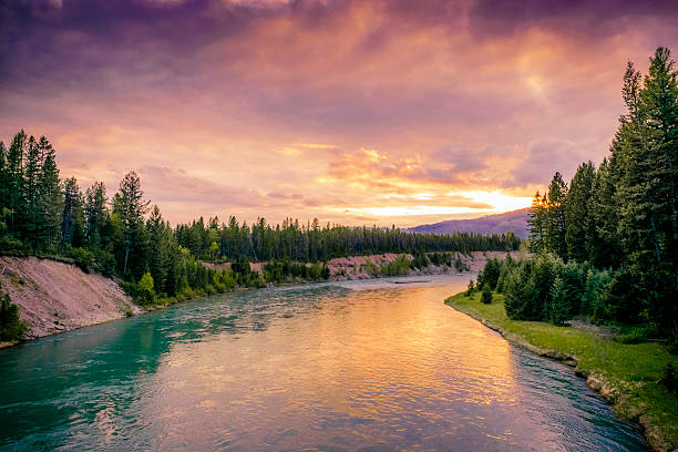 colorful montana sunset in glacier national park over river scene - us glacier national park stock pictures, royalty-free photos & images