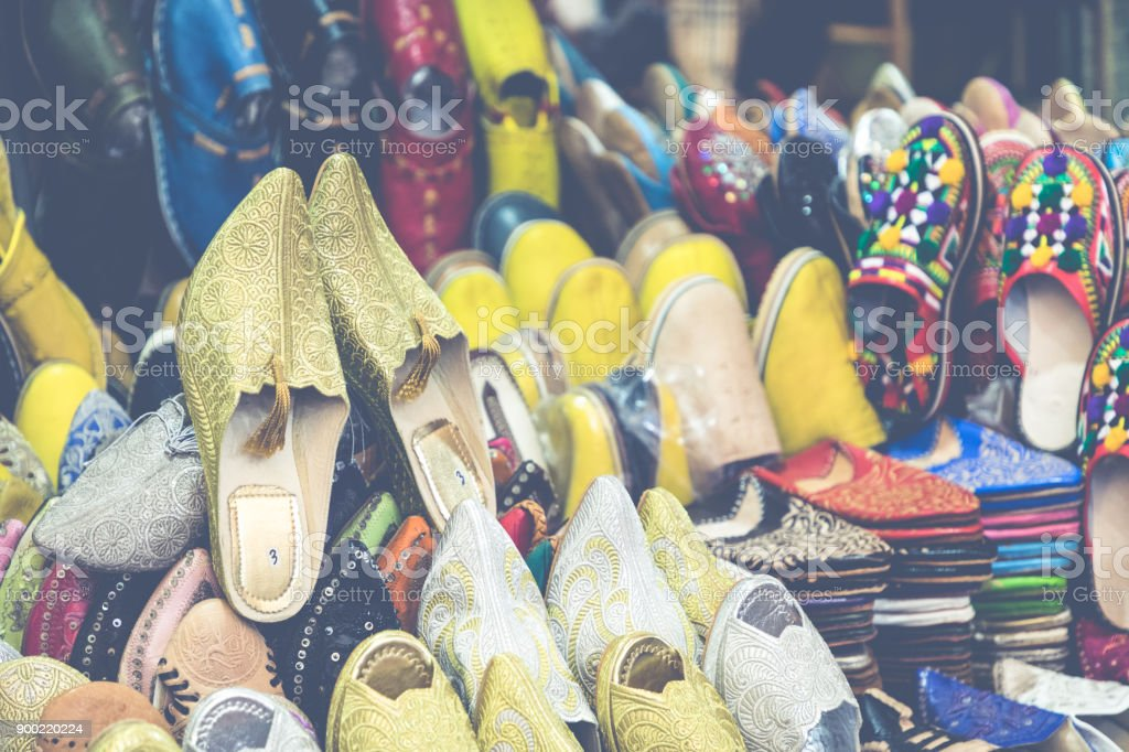 cc403f9feff3 Colorful Moroccan shoes alignment in a shop. Oriental shoes in a bazaar.  Multicolored Moroccan slippers. Colorful leather slippers for sale in the  souk in ...