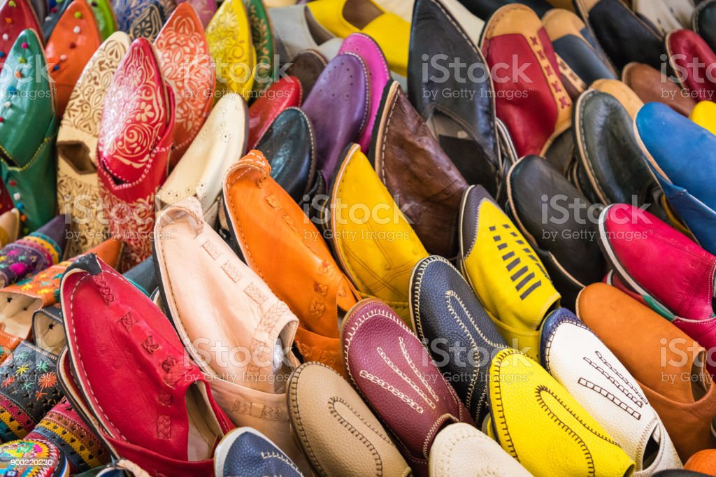 68404f3e2937 Colorful Moroccan shoes alignment in a shop. Oriental shoes in a bazaar.  Multicolored Moroccan slippers. Colorful leather slippers for sale in the  souk in ...