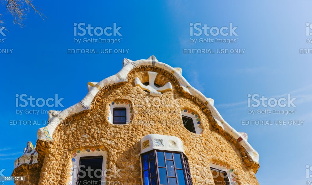 Colorful mosaic building in Park Guell. Evening warm Sun light, Barcelona, Spain royalty-free stock photo