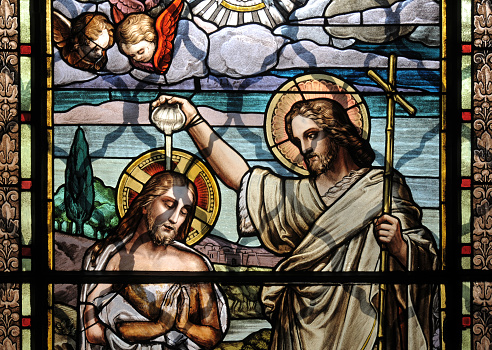 Colorful mosaic glass art of the Baptism of Jesus