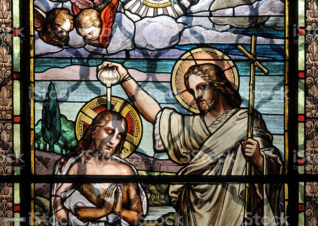 Colorful mosaic glass art of the Baptism of Jesus stock photo