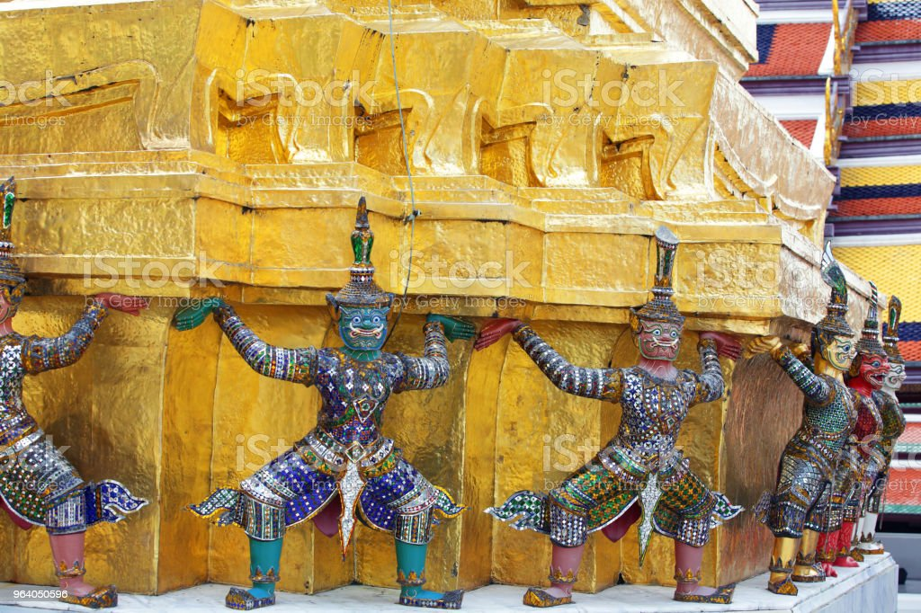 colorful mosaic glass demon statue which support tradition golden chedi - Royalty-free Ancient Stock Photo