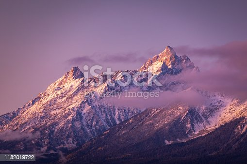 Colorful mountain peak covered by snow and cloud of Grand Teton National Park, Wyoming, USA at sunrise.