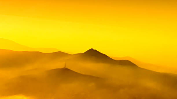 colorful mountains in clouds - like painting, defocused, abstract stock photo