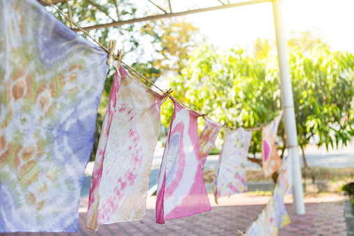 Colorful Natural Tie Dye Clothe hanging on string, natural handmade product