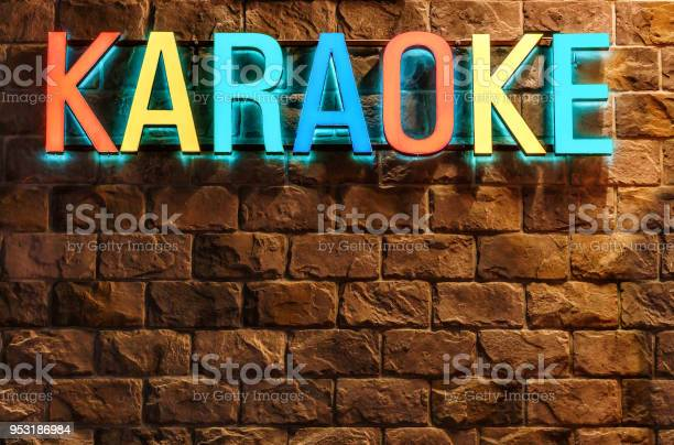 Colorful neon illuminated karaoke sign on stone building wall at picture id953186984?b=1&k=6&m=953186984&s=612x612&h=go3hezrvwgsazablhc equww2stzz2 i didnwaja4u=
