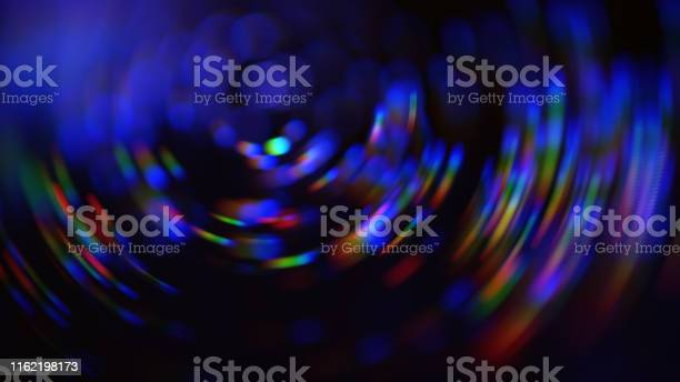 Photo of Colorful Neon Spiral Nebula Galaxy Swirl Pattern Rotor Abstract Blur Motion Speed Bokeh Black Background